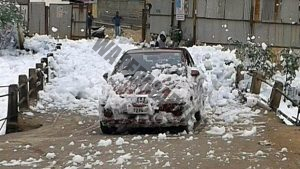 A car covered in the froth that started rising from Bellanduru lake